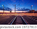 Railroad crossing with car lights in motion. Night 19727813