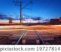 Railroad crossing with car lights in motion. Night 19727814