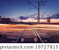 Railroad crossing with car lights in motion. Night 19727815