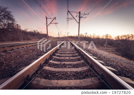 Railway station at sunset. Railroad 19727820