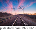 Railway station at sunset. Railroad 19727823