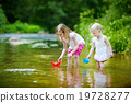 Two little sisters playing with paper boats 19728277