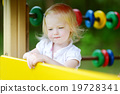 Little girl having fun at a playground 19728341
