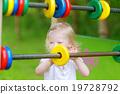Toddler girl having fun at a playground 19728792