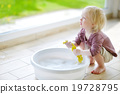 Little toddler girl helping her mom to clean up 19728795