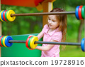 Little girl having fun at a playground 19728916