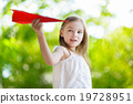 Adorable little girl holding a paper plane 19728951