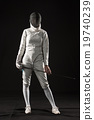 The portrait of woman wearing white fencing 19740239