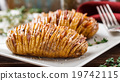 Baked hasselback potatoes  19742115
