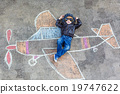 Little boy having fun with airplane picture 19747622