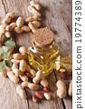 Natural peanut oil in a glass jar close up 19774389