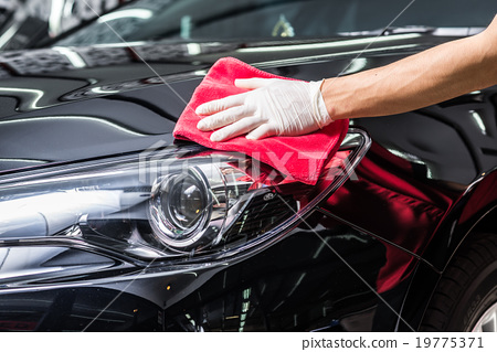Stock Photo: Car polishing series : Cleaning black car