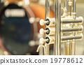 Trumpet on drum background 19778612