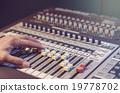 Hand adjusting audio mixer 19778702