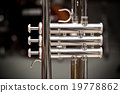 Trumpet on drum background 19778862