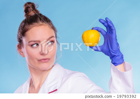 Stock Photo: Scientist doctor with rotten apple. GM food.