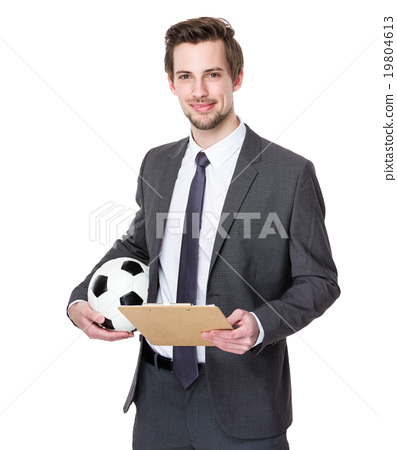 Businessman holding football on white 19804613