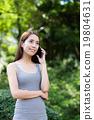 Asian woman talk to cellphone 19804631