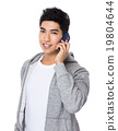 Asian man talk to cellphone 19804644