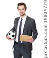 Football trainer hold with soccer ball and clipboard 19804729