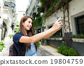 Woman using cellphone for taking photo 19804759