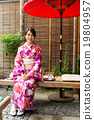 Woman with kimono dress and sitting in the tea house 19804957