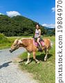 Girl rides a horse 19804970