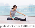 Young Woman do stretching at outdoor 19805014