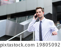 Young businessman talk to cellphone at outdoor 19805092