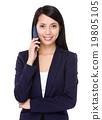 Businesswoman chat on cellphone 19805105