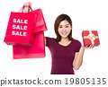 Woman hold with shopping bag and giftbox showing three sale word 19805135