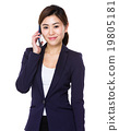 Young businesswoman talk to mobile phone 19805181