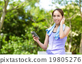 Sporty woman hold with cellphone and listen to music 19805276