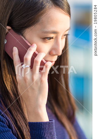 Beautiful smiling young woman talking on cell phone 19805284
