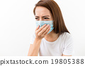 Asian woman using the medical face mask 19805388