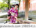 Japanese woman using the water bamboo ladle for purification 19805411