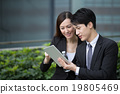 Business man and woman discuss about the financial plan on digit 19805469