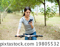 Woman use of the mobile phone for looking into the map 19805532