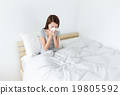 Woman sneeze on the bed 19805592