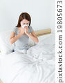 Woman runny nose on the bed 19805673