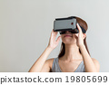 Woman hand holding with VR device 19805699