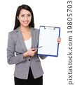 Young businesswoman pen point to blank page of clipboard 19805703