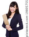 Asian young Businesswoman carry with clipboard 19805755