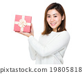 Young woman show with giftbox 19805818