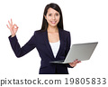 Asian businesswoman hold with laptop computer and ok sign 19805833
