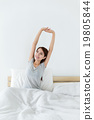 Woman just wakeup and raised hand up 19805844