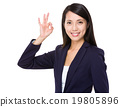 Asian businesswoman with ok gesture 19805896