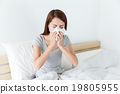 Asian woman feeling unwell and sneeze on bed 19805955