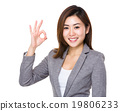 Asian businesswoman with ok sign gesture 19806233