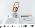Woman just wake up with hand stretching 19806285